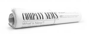 Rolled up newspaper with Company News on it. All text created by photographer. Concept for NEWS section of website.